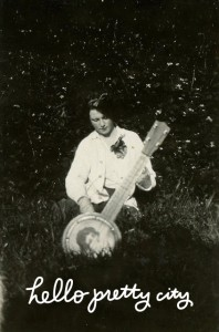 woman in yard with guitar_hpc
